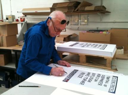 Conrad signs the prints